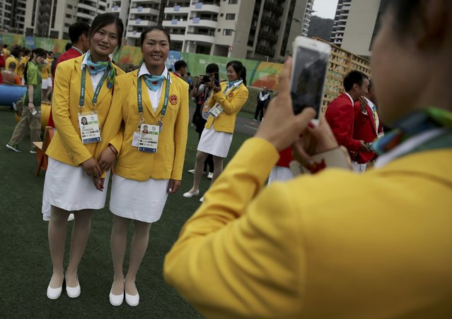 Chinese athletes pose for a picture as they arrive at the Olympic Village in Rio de Janeiro, Brazil on August 3, 2016. (Photo by Alkis Konstantinidis/Reuters)