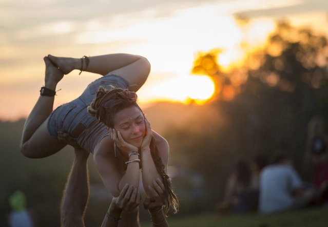 Festival goer practice yoga during the O.Z.O.R.A. festival on August 4, 2016 in Tolna, Hungary. Ozora is a village in Tolna County. In recent times it has become famous for the O.Z.O.R.A. psychedelic trance festival which has been held on an estate in Ozora near small village Dadpuszta every year since 2004. The first party was called Solipse and took place during the Solar eclipse of August 11, 1999. The Ozora festival (with Solar United Natives festival) is one of the two big psytrance festivals in Hungary, and is fastest growing psytrance festivals on the world, achieving incredible 60 000 visitors in 2015. (Photo by Mohai Balázs/MTI/MTVA)