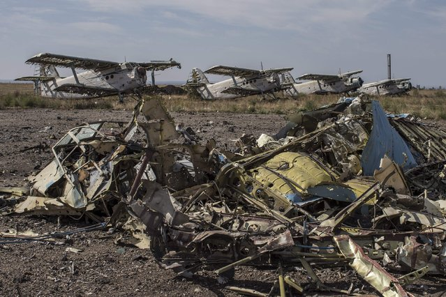 Damaged planes are seen at the destroyed airport in Luhanks, eastern Ukraine, September 14, 2014. (Photo by Marko Djurica/Reuters)