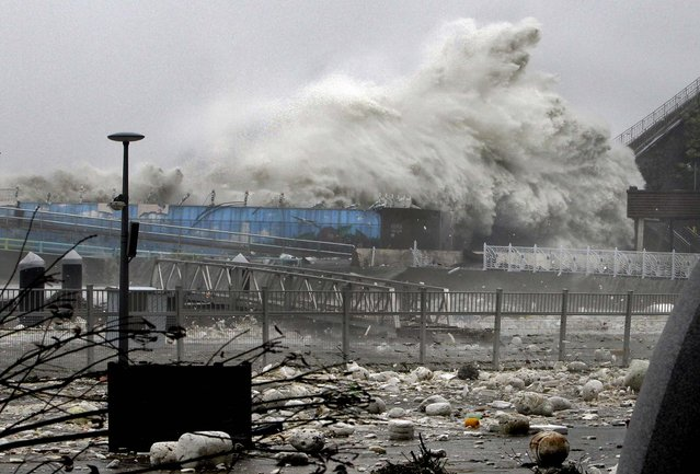 High waves, caused by Typhoon Sanba, crash on a seaside road in Yeosu, south of Seoul, South Korea, on September 17, 2012. (Photo by Yonhap, Hyung Min-soo/Associated Press)