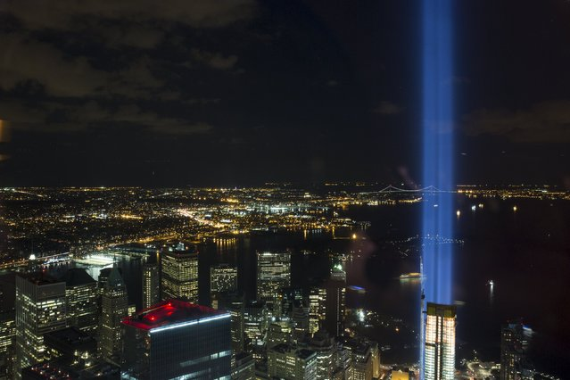The Tribute in Light installation is seen from One World Observatory, the observation deck at One World Trade Center, in Lower Manhattan in New York September 11, 2015. (Photo by Andrew Kelly/Reuters)