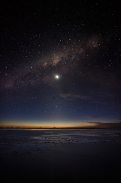 """Sunset Milky Way"". In sunset time in Uyuni lake. Only this time, we can see nice sunset and Milky Way. The sunset light and night light mixed this point. Photo location: Uyuni lake in Bolivia. (Photo and caption by Yosuke Yamada/National Geographic Photo Contest)"