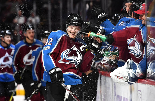 Colorado Avalanche left wing Gabriel Landeskog (92) is sprayed by goalie Jonathan Bernier (45) following his hat trick goal in the third period against the Washington Capitals at the Pepsi Center in Denver, CO, USA on November 16, 2017. (Photo by Ron Chenoy/USA TODAY Sports)