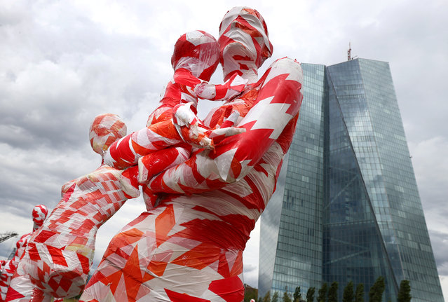 "A partially incomplete display of mannequins wrapped in a barrier tape to symbolise the coronavirus disease (COVID-19) crisis, as part of the art installation ""It is like it is"" by German art student Dennis Josef Meseg, is seen in front of the European Central Bank (ECB) head quarters in Frankfurt, Germany on June 28, 2020. (Photo by Kai Pfaffenbach/Reuters)"
