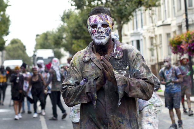 A reveller starts the day's celebrations as Notting Hill Carnival begins on August 28, 2016 in London, England. The Notting Hill Carnival has taken place every year since 1966 in Notting Hill in north-west London and is one of the largest street festivals in Europe with more than a million people expected over two days. (Photo by Ben A. Pruchnie/Getty Images)