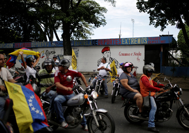Opposition supporters take part in a rally to demand a referendum to remove Venezuela's President Nicolas Maduro, in Caracas, Venezuela, September 1, 2016. (Photo by Marco Bello/Reuters)