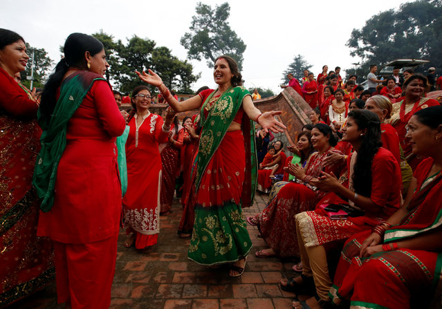 Women sing and dance at the Pashupatinath Temple during the Teej festival in Kathmandu, Nepal September 4, 2016. (Photo by Navesh Chitrakar/Reuters)