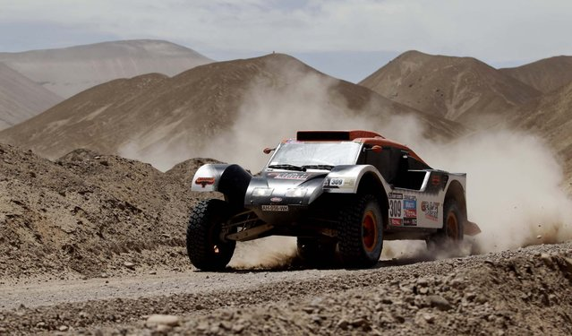 Guerlain Chicherit and co-driver Jean-Pierre Garcin, both of France, compete in the 5th stage. (Photo by Victor R. Caivano/Associated Press)