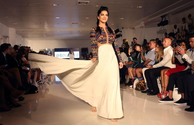 Indian Bollywood actress Sunny Leone walks the runway wearing designer Archana Kochhar's creations during the FTL Moda presentation at New York Fashion Week on September 8, 2016. (Photo by Trevor Collens/AFP Photo)