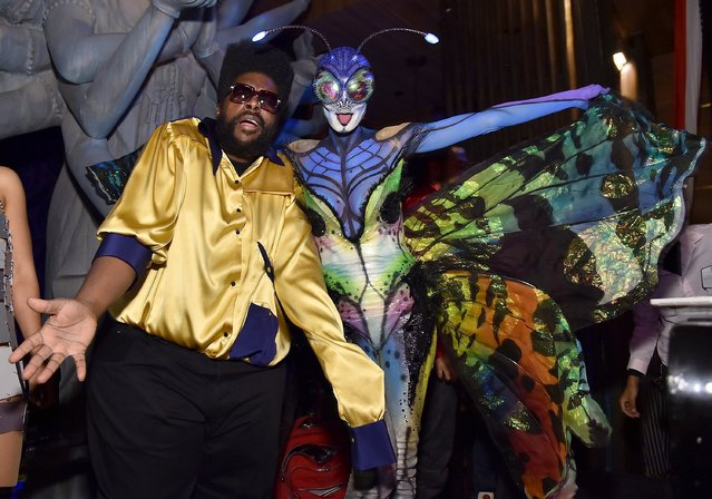 Questlove and Heidi Klum attend Moto X presents Heidi Klum's 15th Annual Halloween Party sponsored by SVEDKA Vodka at TAO Downtown on October 31, 2014 in New York City. (Photo by Mike Coppola/Getty Images for Heidi Klum)