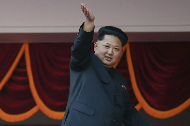 North Korean leader Kim Jong Un waves to the crowd during the parade celebrating the 70th anniversary of the founding of the ruling Workers' Party of Korea, in Pyongyang October 10, 2015. (Photo by Damir Sagolj/Reuters)