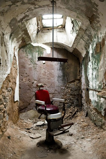 This October 13, 2014, photo shows a barber shop in cellblock 10 at Eastern State Penitentiary in Philadelphia. The penitentiary took in its first inmate in 1829, closed in 1971 and reopened as a museum in 1994. (Photo by Matt Rourke/AP Photo)