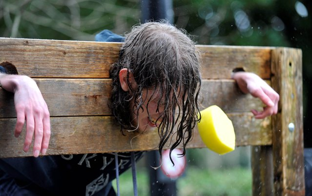Irish Examiner News  Picture 12-02-2013. Conor O'Donoghue getting hit by a wet sponge during Rag week at UCC. Picture Dan Linehan