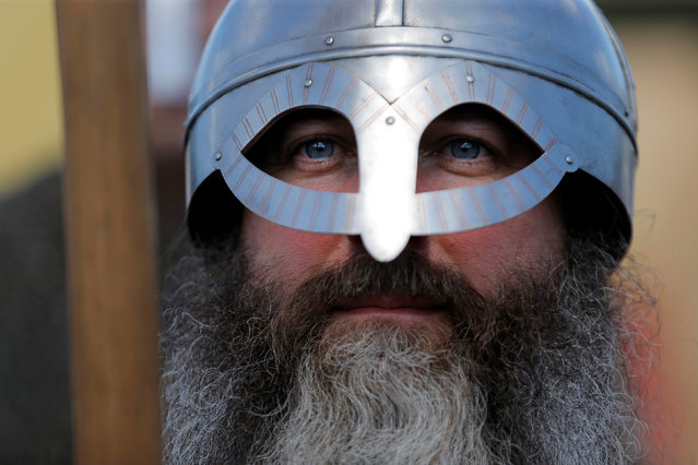 An actor portraying a member of medieval infantry waits to participate in a viking battle at the St Ives Medieval Fair in Sydney, one of the largest of its kind in Australia, September 24, 2016. (Photo by Jason Reed/Reuters)