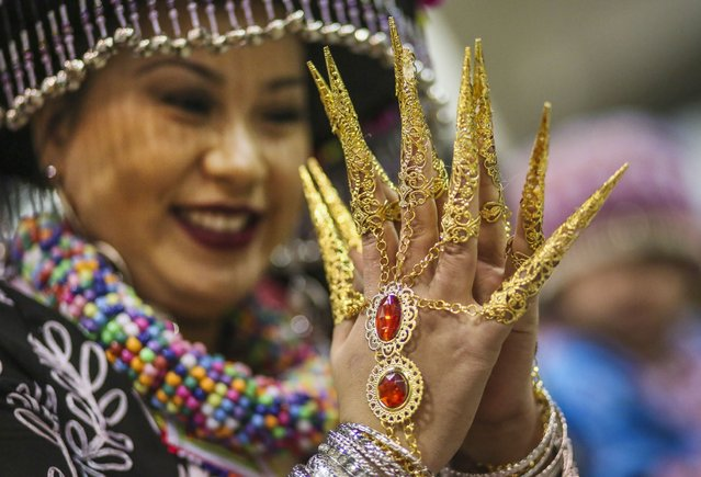 Kia Vue of St. Paul sports long nails at the Minnesota Hmong New Year celebration Saturday, November 29, 2014, at the Saint Paul RiverCentre in St. Paul, MN. (Photo by David Joles/Star Tribune)