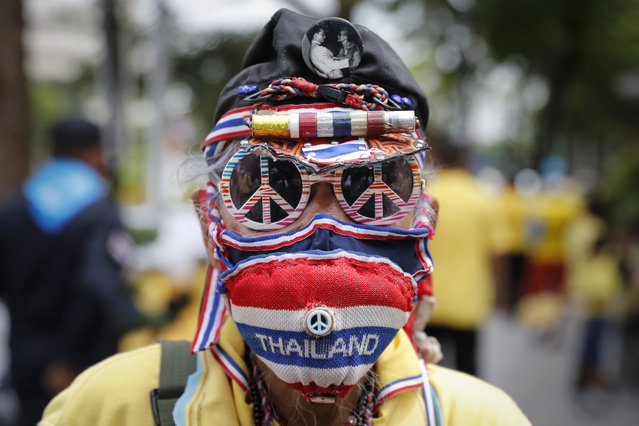 A supporter of the Thai monarchy disguises himself during a rally in Bangkok, Thailand, Wednesday, October 14, 2020. Anti-government protesters began gathering Wednesday for a planned rally at Bangkok's Democracy Monument being held on the anniversary of a 1973 popular uprising that led to the ousting of a military dictatorship, amid a heavy police presence and fear of clashes with political opponents. (Photo by Gemunu Amarasinghe/AP Photo)