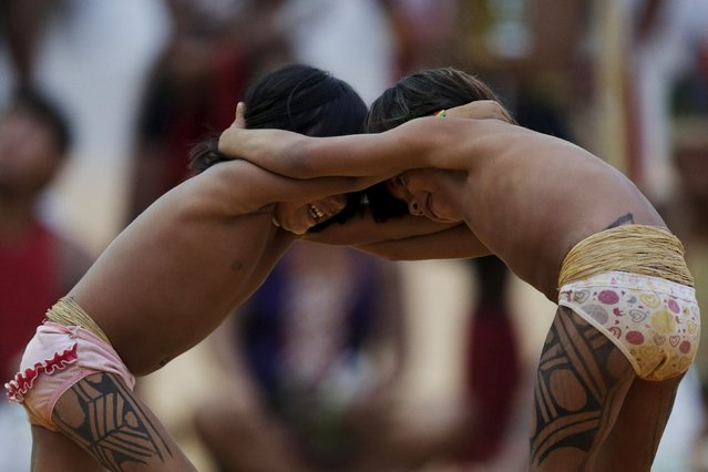 Indigenous children play wrestle during the first World Games for Indigenous Peoples in Palmas, Brazil, October 25, 2015. (Photo by Ueslei Marcelino/Reuters)