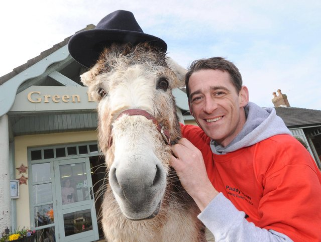 Davy Russell, the Irish champion jockey, with one of the donkeys, Sarkozy Browne, for the Paddy Power Celebrity Donkey Derby in Youghal, March 22, 2013, to raise funds for the Queen of the Sea Festival (July 12th-14th) which in turn will benefit Youghal lifeboat and Childline. (Photo by Denis Minihane)