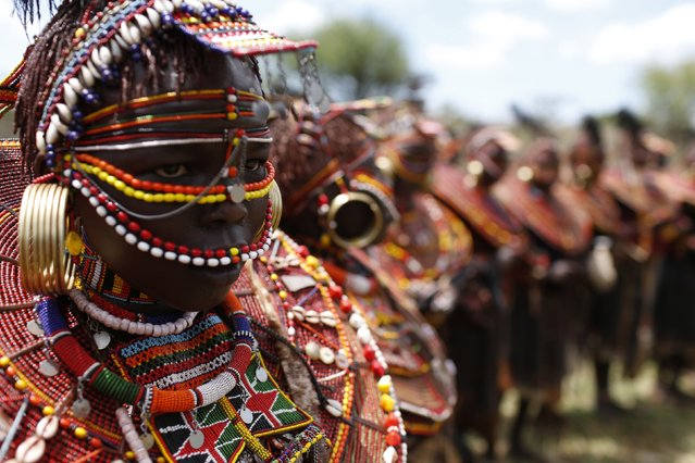 Pokot girls attired with traditional jewellery stand in a circle during an initiation ceremony of over a hundred girls passing over into womanhood, about 80 km (50 miles) from the town of Marigat in Baringo County December 6, 2014. (Photo by Siegfried Modola/Reuters)