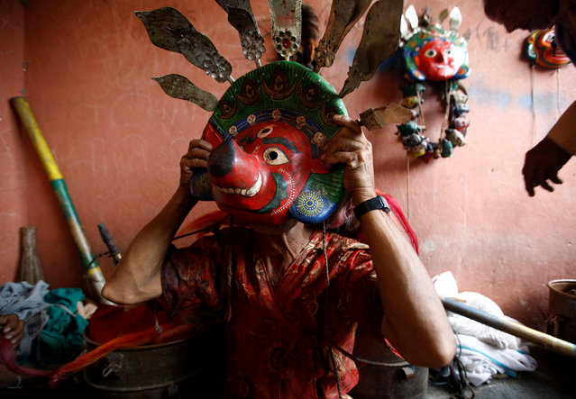 A medium prepares for a deity's procession during the Shikali festival at Khokana village in Lalitpur, Nepal October 7, 2016. (Photo by Navesh Chitrakar/Reuters)