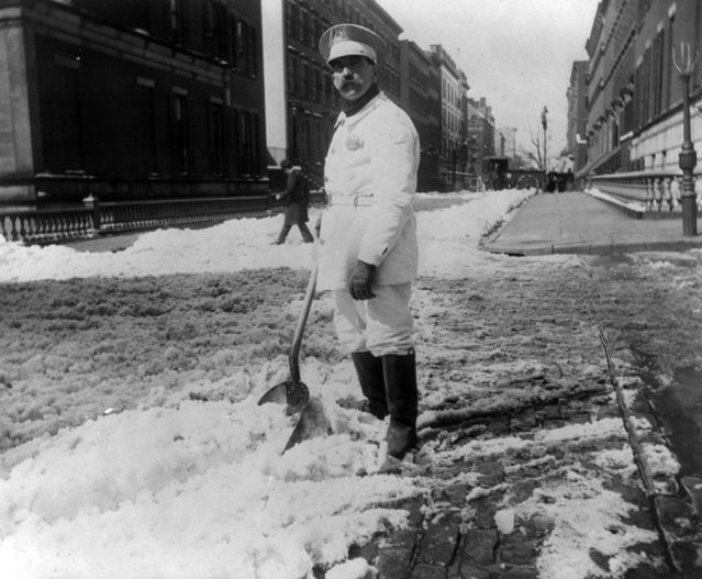 Street types of New York City: Street cleaner with rubber boots shoveling snow,  circa 1896. (Photo by Elizabeth Alice Austen)