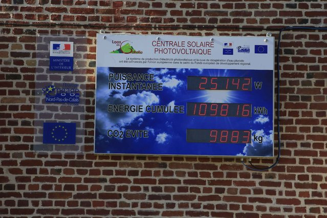 A view shows an energy economies counter of a photovoltaic solar power installation on the wall of a church in Loos-en-Gohelle, northern France November 1, 2015. (Photo by Pascal Rossignol/Reuters)