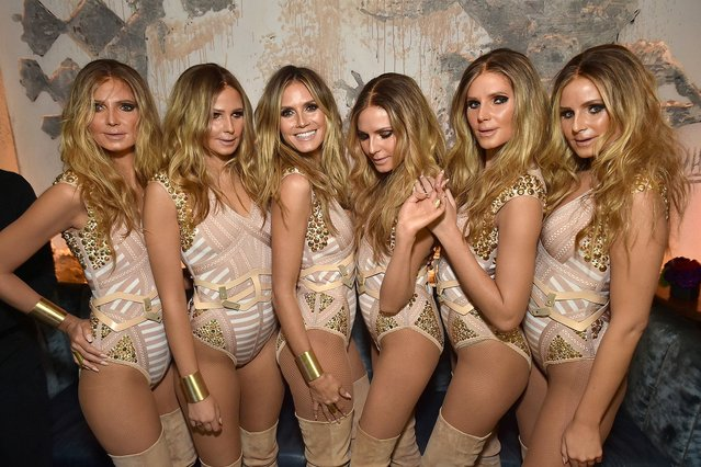 Model Heidi Klum (3rd L) reveals her costume during Heidi Klum's 17th Annual Halloween Party sponsored by SVEDKA Vodka at Vandal on October 31, 2016 in New York City. (Photo by Mike Coppola/Getty Images for Heidi Klum)