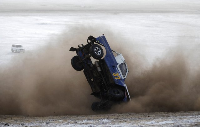 A car overturns during the Master Cross Race 2014 at Suuj Uul, outside Ulan Bator, December 14, 2014. (Photo by B. Rentsendorj/Reuters)