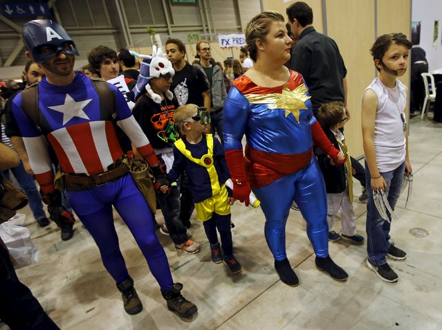 Members of a family dressed in superhero costumes attend the second edition of the Hero Festival in Marseille, France November 7, 2015. (Photo by Jean-Paul Pelissier/Reuters)