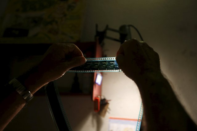Projectionist Antonio Feliciano, 75, spools film onto projection reels at Girasol cinema in Vila Nova de Milfontes, Portugal August 31, 2013. (Photo by Rafael Marchante/Reuters)