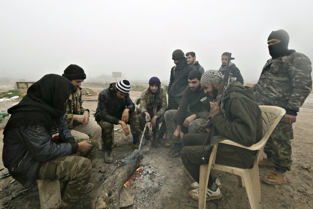 Ahrar al-Sham Islamic fighters rest near a checkpoint beside al-Hamidiyeh base, one of two military posts they took control of from forces loyal to Syria's President Bashar al-Assad in the southern Idlib countryside, December 19, 2014. (Photo by Khalil Ashawi/Reuters)