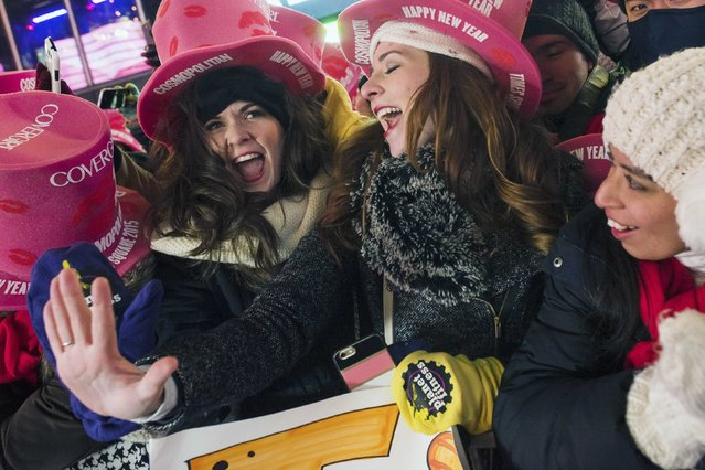 Revelers Nicola Barrett (L) and Summer Equitz sing at Times Square during New Year's Eve celebrations in New York December 31, 2014. (Photo by Keith Bedford/Reuters)