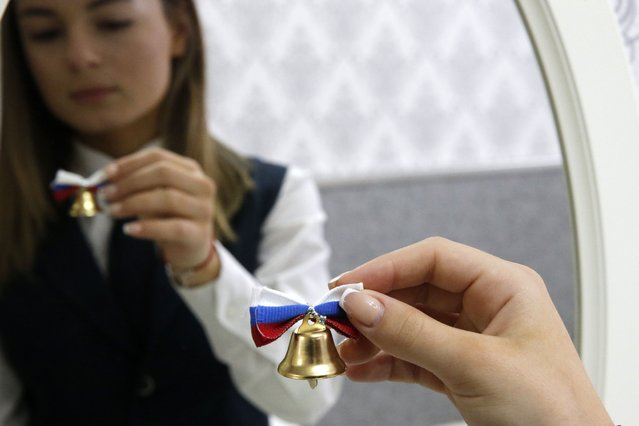 Final-year student Alina Repkina prepares for a livestream of the Last Bell ceremony for school leavers at secondary school No 11 in Rostov-On-Don, Russia on May 30, 2020. It is the first time in Russia that such ceremonies have been held via video link due to the coronavirus lockdown restrictions. (Photo by Valery Matytsin/TASS)