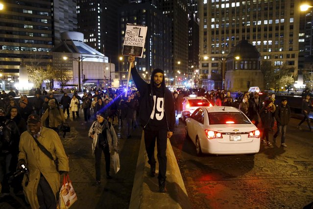 Protesters demonstrate in response to the fatal shooting of Laquan McDonald in Chicago, Illinois, November 25, 2015. (Photo by Andrew Nelles/Reuters)