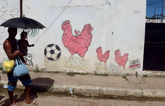 Picture of a graffiti on a wall in a shantytown of Olinda, near Recife in northeastern Brazil, taken on June 18, 2013 during the FIFA Confederations Cup Brazil 2013 football tournament. (Photo by Vincenzo Pinto/AFP Photo)