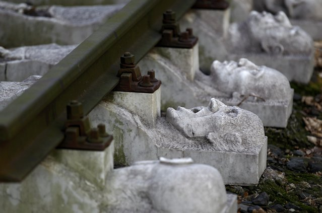 Part of a memorial to the victims of forced labour of a National Rail (Reichsbahn) workshop is seen next to a former Nazi SS guards barracks of Buchenwald concentration camp in Schwerte, near the western German town of Dortmund January 13, 2015. The city of Schwerte plans to house 21 asylum seekers in the former Nazi SS guards barracks, German newspaper Westdeutsche Allgemeine Zeitung (WAZ) reported on Monday. (Photo by Ina Fassbender/Reuters)