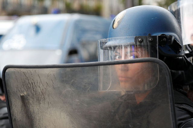 A gendarme in riot gear is seen during a demonstration in Paris, on July 14, 2020, as part of a nationwide day of protests by health workers to demand better work conditions. Health care workers are protesting in France on the country's National day to demand more for their sector a day after the government and unions signed an agreement giving over eight billion euros in pay rises, with the prime minister admitting the move was overdue in view of the coronavirus pandemic. (Photo by Zakaria Abdelkafi/AFP Photo)