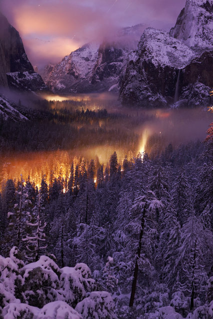 """Yosemite Valley at Night"". The mist on the valley floor reflects car lights driving through. Location: Yosemite National Park. (Photo and caption by Phil Hawkins/National Geographic Traveler Photo Contest)"