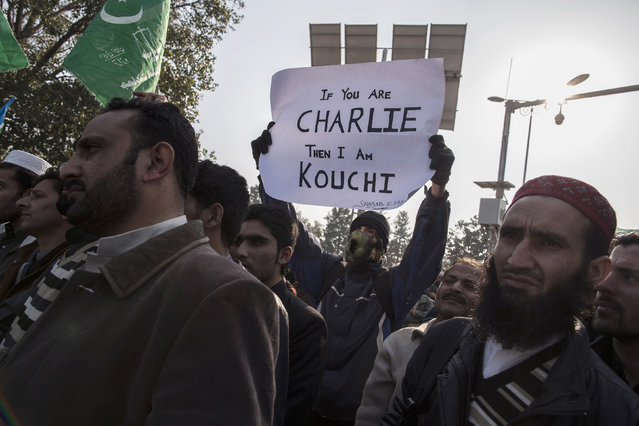 A supporter of the Islamic political party Jamaat-e-Islami holds a sign as he listens to a speech with others during a protest against satirical French weekly Charlie Hebdo, in Islamabad January 16, 2015. (Photo by Zohra Bensemra/Reuters)