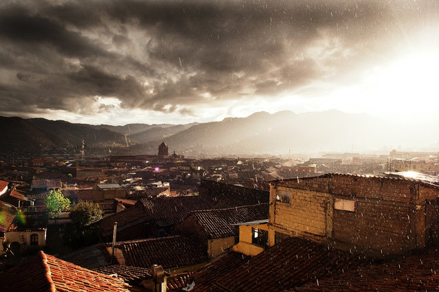 """Cusco Sunset"". The view from our hotel room in the San Blas district of Cusco. This area of town overlooked the rest of the city and gave us a breathtaking view as the sun & rain mixed one evening. Location: Cusco, Peru. (Photo and caption by Blake Burton/National Geographic Traveler Photo Contest)"