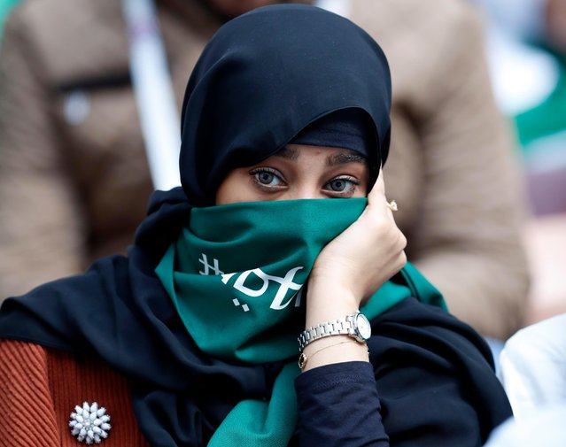 A Saudi Arabia fan waits for the start of the group A match between Russia and Saudi Arabia which opens the 2018 soccer World Cup at the Luzhniki stadium in Moscow, Russia, Thursday, June 14, 2018. (Photo by Pavel Golovkin/AP Photo)