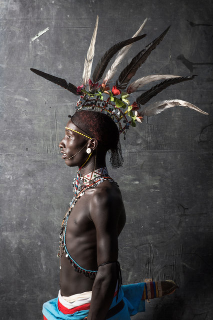 """""""Samburu Warrior"""". A young warrior of the Samburu Tribe in Kenya in his striking traditional clothing. Strong, proud, confident, fierce, stoic. He was absolutely exquisite. Location: South Horr, Kenya. (Photo and caption by Tierney Farrell/National Geographic Traveler Photo Contest)"""