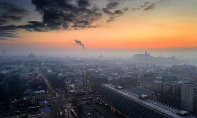An aerial picture taken with a drone shows a wispy blanket of smog over Krakow, southern Poland, 11 January 2021. Despite movement restrictions implemented to stem the spreading of the coronavirus disease (COVID-19) pandemic, air pollution levels across Krakow still remain relatively high. (Photo by Lukasz Gagulski/EPA/EFE)