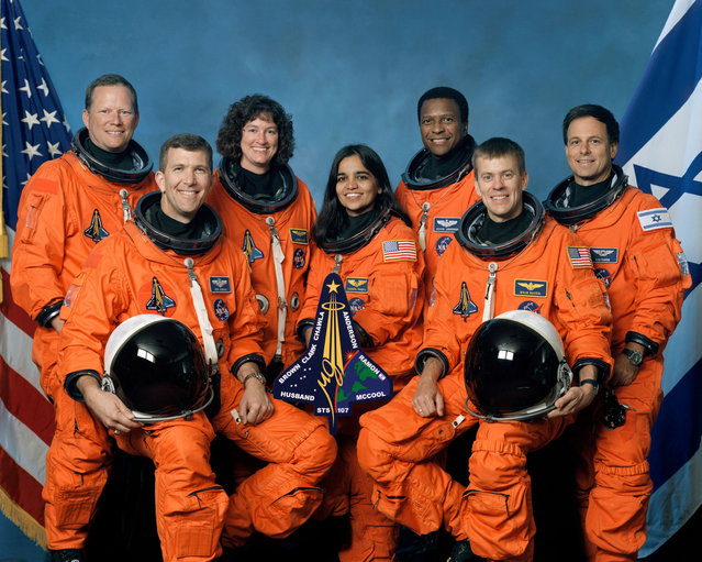 This undated file photo released by NASA shows space shuttle Columbia STS-107 crew members from left to right, front row, commander Rick Husband, mission specialist Kalpana Chawla, pilot William McCool, back row, mission specialist David Brown, mission specialist Laurel Clark, payload commander Michael Anderson and payload specialist Ilan Ramon of Israel. Space Shuttle Columbia disintegrated over Texas on February 1, 2003. (Photo by AP Photo/NASA)