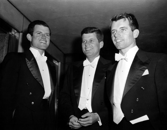 Sen. John F. Kennedy, center, D-Mass., and his brothers Edward Kennedy, left, a student at the University of Virginia, and Robert F. Kennedy, chief counsel to the Senate Rackets Committee, attend the annual Gridiron Club dinner in Washington, D.C., on March 15, 1958. (Photo by AP Photo)