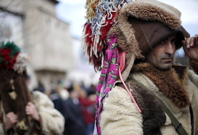"Men dressed in costumes made of animal fur, known as ""kukeri"", participate in the International Festival of the Masquerade Games in the town of Pernik January 31, 2015. (Photo by Stoyan Nenov/Reuters)"