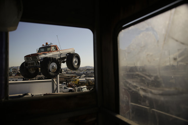 In this Wednesday, November 11, 2015 photo, junks cars are seen through the window of a watch shack at Aadlen Brothers Auto Wrecking, also known as U Pick Parts, in the Sun Valley section of Los Angeles. (Photo by Jae C. Hong/AP Photo)