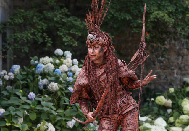"An artist called ""L'Amazone"" takes part in the festival ""Statues en Marche"" in Marche-en-Famenne, Belgium, July 22, 2018. (Photo by Yves Herman/Reuters)"
