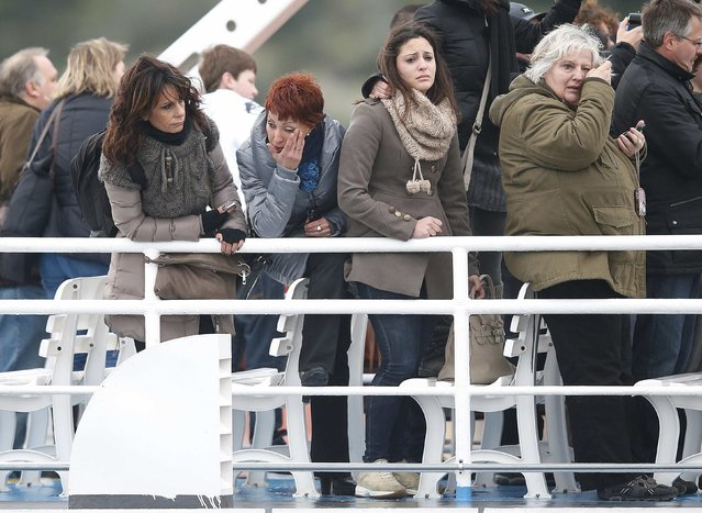 Relatives of victims cry as they stand on a ferry during a ceremony to commemorate the first anniversary of the Costa Concordia shipwreck, in which 32 people died, outside Giglio harbour in this January 13, 2013 file photo. (Photo by Tony Gentile/Reuters)