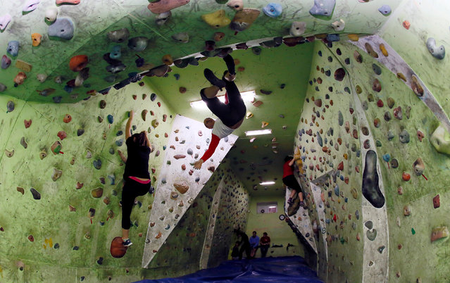 "Members of the ""Centre of Travelles"" youth sports club train on climbing bouldering walls at a rock climbing gym in the Siberian city of Krasnoyarsk, Russia, November 23, 2016. (Photo by Ilya Naymushin/Reuters)"